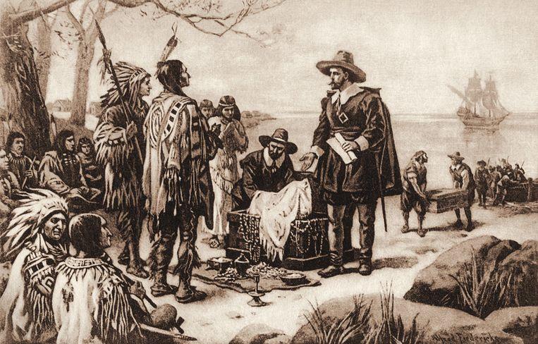 Prent verbeeldt hoe Pierre Minuit (staand) in 1626 inheemse bewoners mooie spullen aanbiedt in ruil voor hun eiland Manhattan. Beeld getty