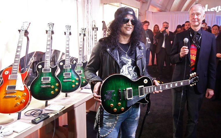 Guns N' Roses-gitarist Slash met zijn Gibson. Beeld EPA