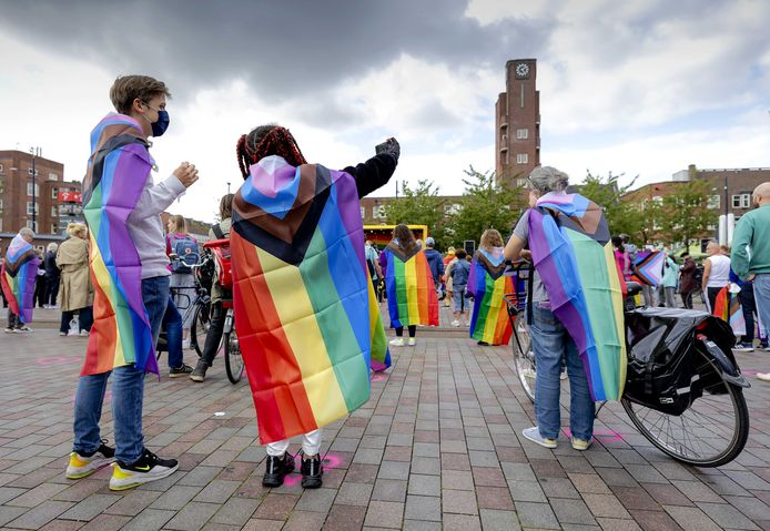 Demonstranten tijdens een demonstratie tegen lhbti-geweld in Amsterdam.