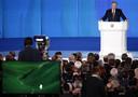 De Russische president Poetin tijdens de speech op 1 maart 2018 waarin hij de nieuwe, niet te onderscheppen superwapens aankondigde