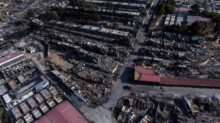 De resten van vluchtelingenkamp Moria, na de verwoestende brand van 9 september die 12.000 mensen dakloos maakte.  Beeld AP