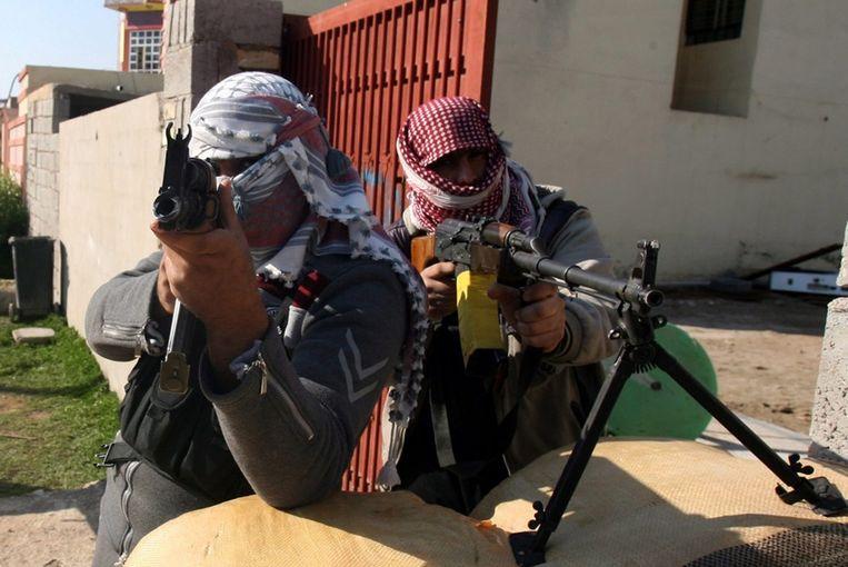 Gemaskerde mannen vandaag in Fallujah, Irak. Beeld epa