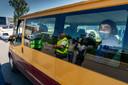 Controle van een werknemersbus bij Vion in Boxtel.