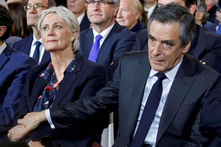 François Fillon en zijn vrouw Penelope. Beeld REUTERS