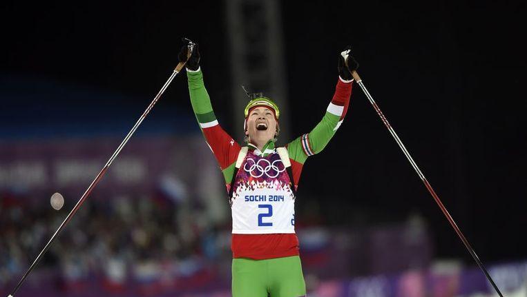 Darja Domratsjeva viert haar winst bij de massastart Beeld afp