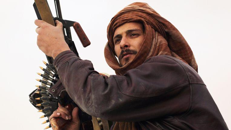 Een lid van een van de vele milities. Beeld Getty Images