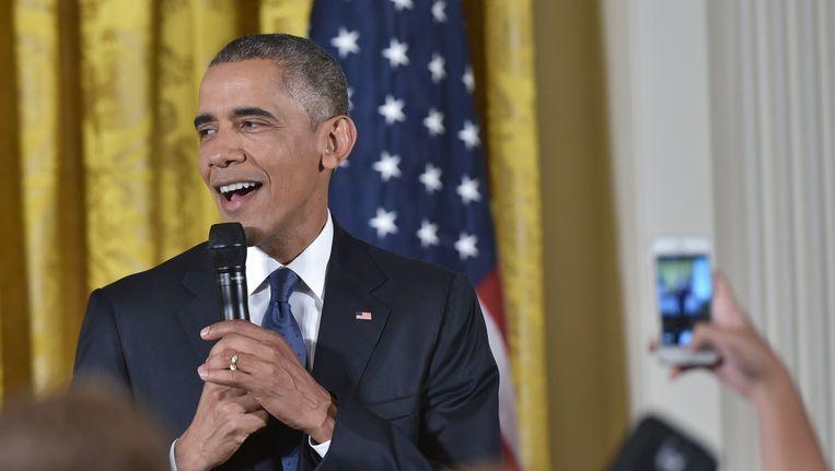 Obama spreekt de leerlingen toe. Beeld afp