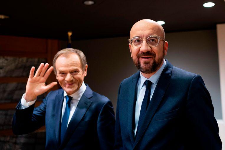 Michel met zijn voorganger Donald Tusk. Die typeerde de job onlangs als 'chef bureaucratie'. Beeld AFP