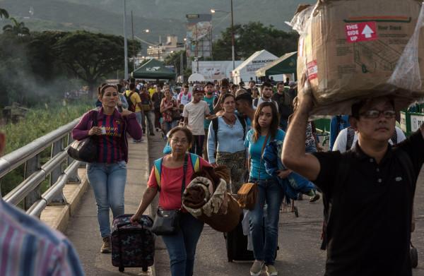 **Colombia kraakt onder stroom van vluchtelingen**