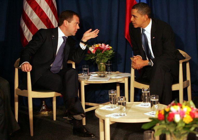 Barack Obama en Dmitry Medvedev op de Round Chair (2009) Beeld Getty Images