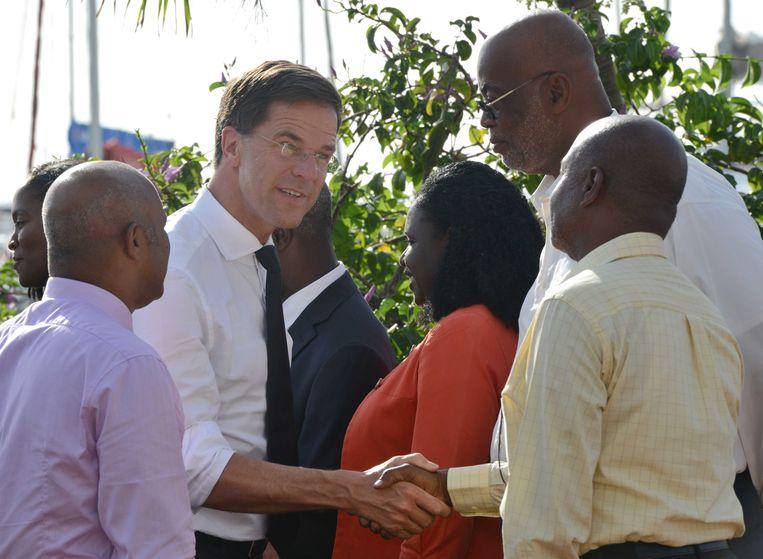 Premier Mark Rutte bracht vorig jaar een bezoek aan Sint-Maarten om de wederopbouw te bekijken.  Beeld ANP