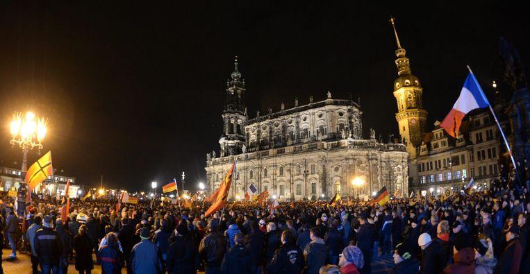 Een bijeenkomst van de anti-islambeweging Pegida in Dresden, Duitsland. Beeld EPA