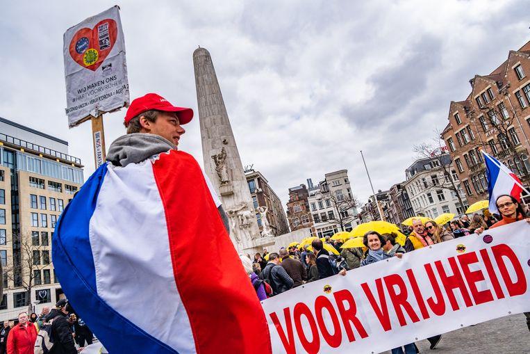 Protest tegen de coronamaatregelen in Amsterdam. Beeld Joris van Gennip