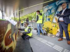 Kunst maken met graffiti op stationsmuur Wierden