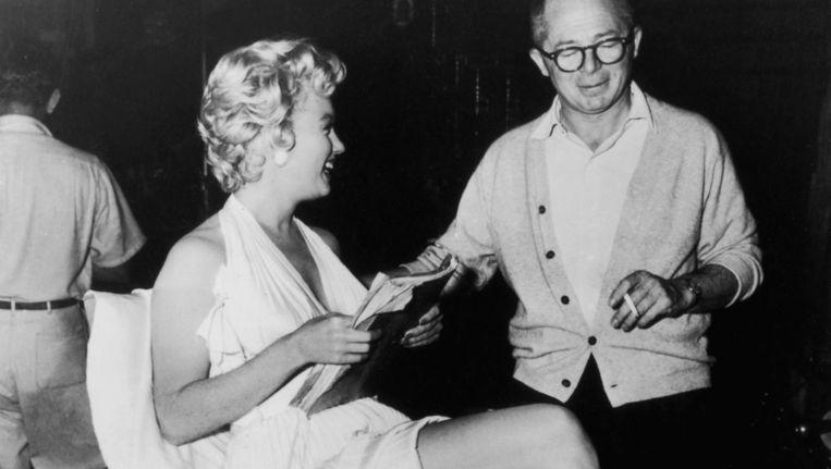 Marilyn Monroe en Billy Wilder in 1955 op de set van The Seven Year Itch Beeld Hulton Archive/Getty