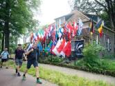 Dit is het vlaggenhuis in Berg en Dal: 26 vlaggen van wandelingen in 26 landen