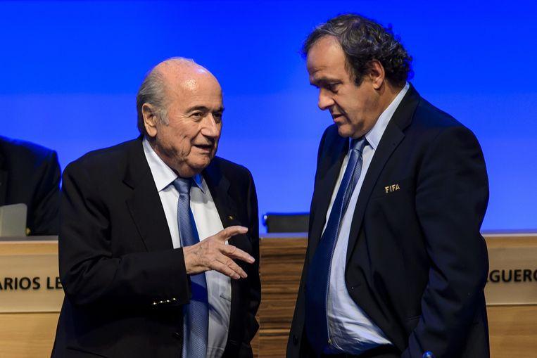 Sepp Blatter (links) en Michel Platini. Beeld AFP