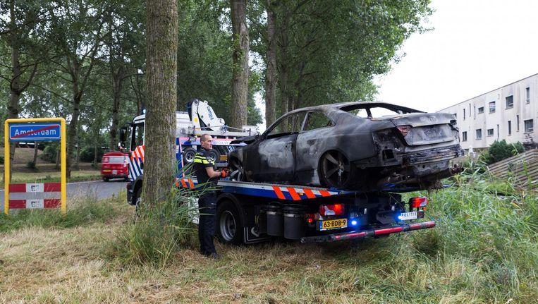 De uitgebrande zwarte Audi die gebruikt is als vluchtauto. Beeld anp
