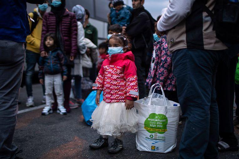 Migranten op het Griekse eiland Lesbos. Beeld AP