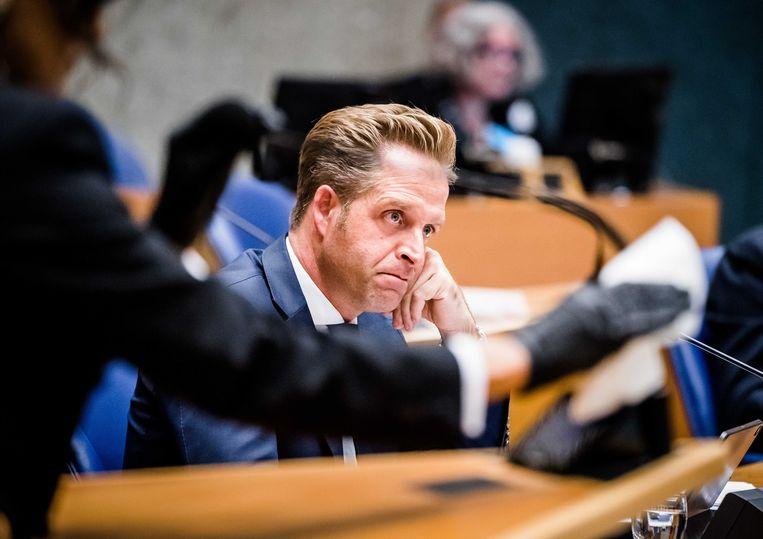 Minister Hugo de Jonge van Volksgezondheid, Welzijn en Sport (CDA) tijdens het Tweede Kamer debat over het coronavirus.  Beeld ANP