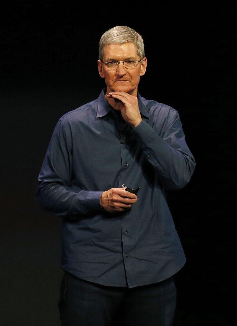 Tim Cook over Apple's 'wearable', de Watch. Cook kreeg veel kritiek omdat het zo lang duurde voordat het concern met iets wezenlijk nieuws kwam. De concurrentie was hem ruim voor. Beeld epa
