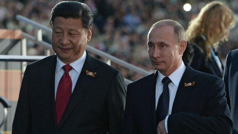 De Russische president Vladimir Poetin en zijn Chinese collega Xi Jinping op de festiviteiten van de 70-jarige herdenking van het einde van de Tweede Wereldoorlog. Beeld PHOTO_NEWS