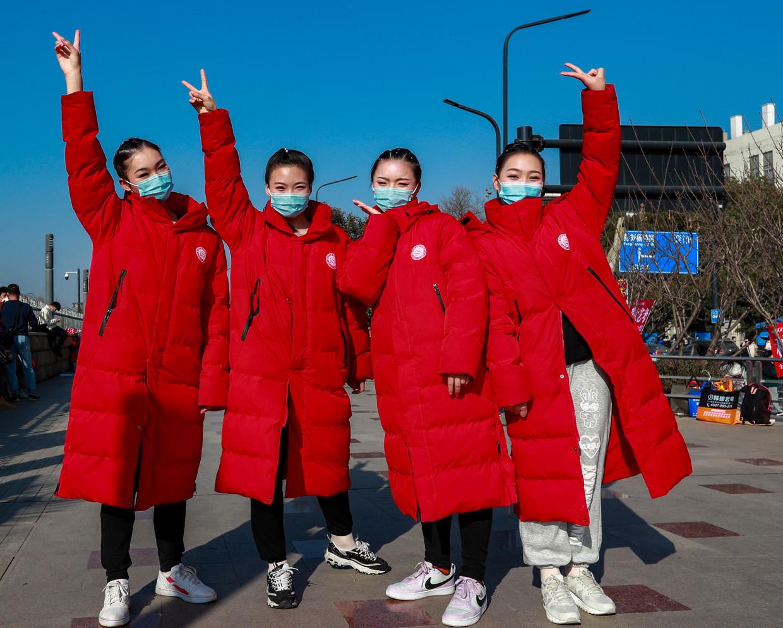 Studenten voor het conservatorium van Wuhan, in januari 2021 Beeld VCG via Getty Images