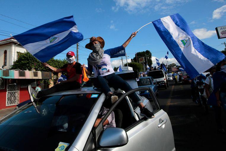 Betogers tijdens een protest tegen president Daniel Ortega's kabinet. Beeld REUTERS