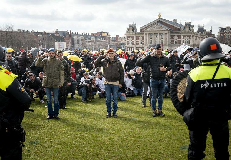 Demonstranten tijdens de World Wide Rally for Freedom and Democracy op het Museumplein. Beeld ANP