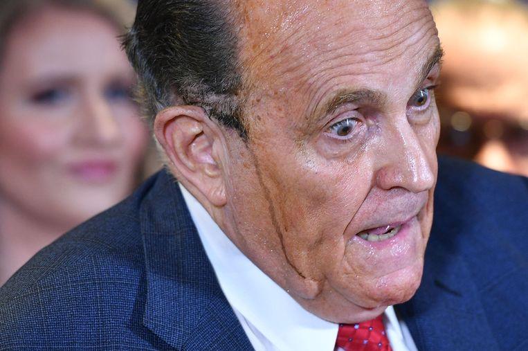 Een zwetende Rudy Giuliani. Beeld AFP