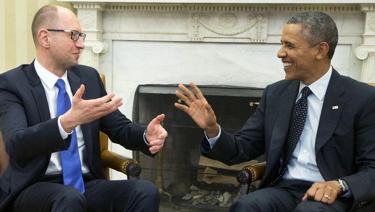 De Oekraïense premier Arseni Jatsenjoek woensdag tijdens zijn bezoek aan Washington met de Amerikaanse president Barack Obama. Beeld ap
