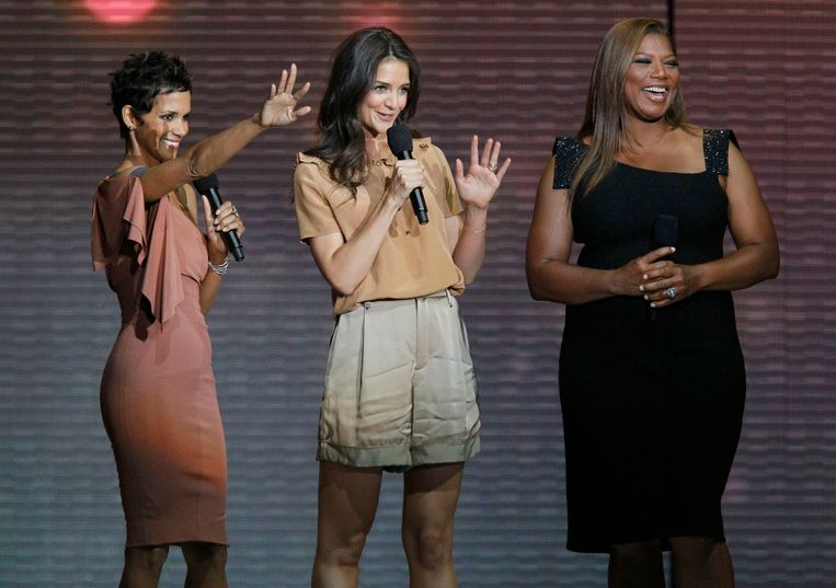 Halle Berry, left, Katie Holmes and Queen Latifah, right, appear during a star-studded double-taping of