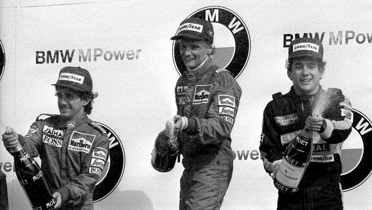 Het podium na de laatste Formule 1-race in Zandvoort, met van links naar rechts Alain Prost, Nikki Lauda en Ayrton Senna. Beeld anp