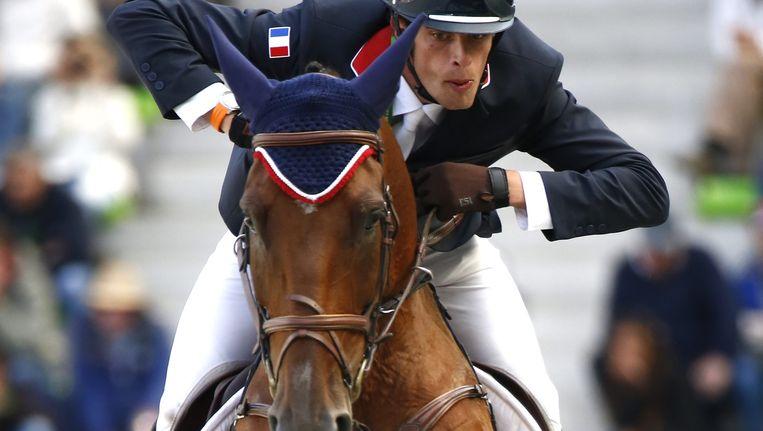 Maxime Livio aan het werk met Qalao des Mers op de Wereldruiterspelen. Beeld EPA