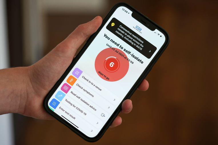 De app van de NHS die gebruikers waarschuwt als ze zijn blootgesteld aan het virus.  Beeld Getty Images