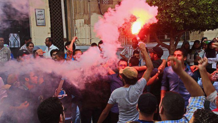 Studenten betogen in de Egyptische hoofdstad Caïro. Beeld PHOTO_NEWS