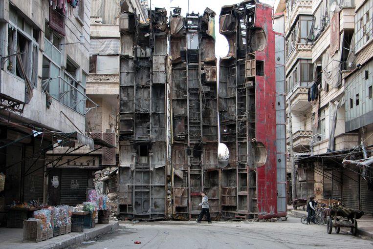 Blokkades van bussen in de Syrische stad Aleppo. Beeld AFP