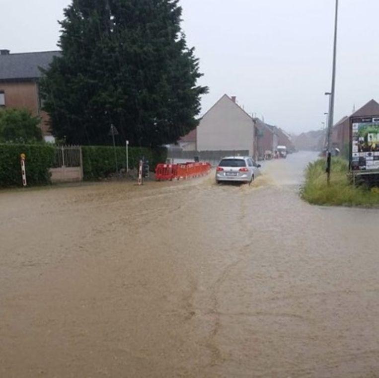 Een kruispunt staat onder water in Rillaar. Beeld RV Facebook