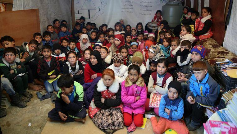 Syrische kinderen in een vluchtelingenkamp in Libanon. Beeld ap