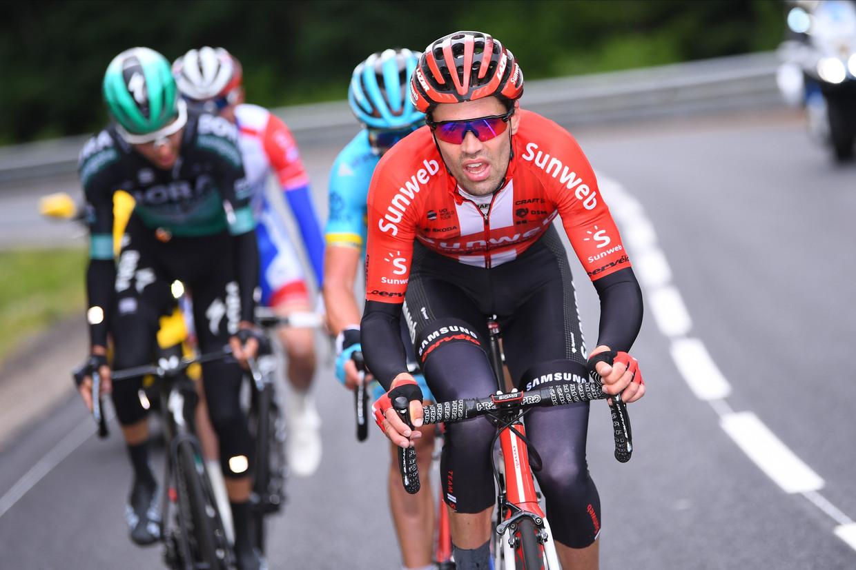 Tom Dumoulin in actie in de Dauphiné. 'Ik wil een weekje stevig koersen zonder veel problemen.'  Beeld Photo News