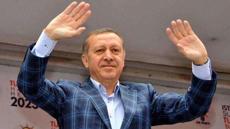 Erdogan blijft zijn geruite jasje consequent dragen. Beeld RV