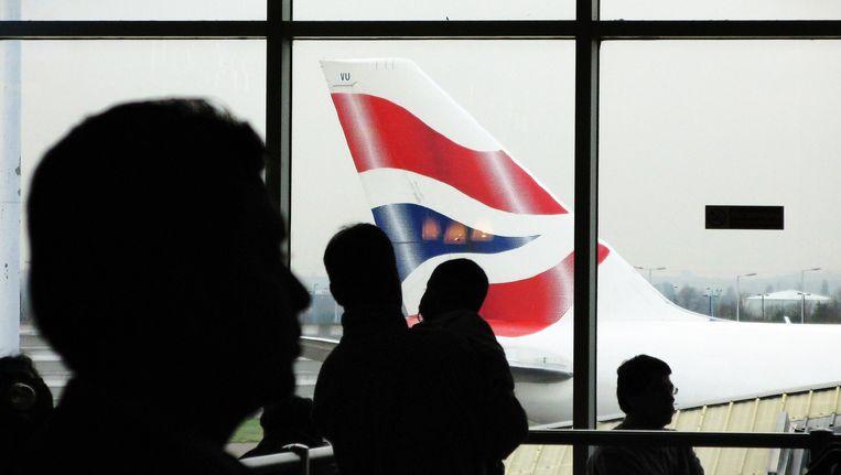 Reizigers op de luchthaven van Heathrow. Beeld AFP