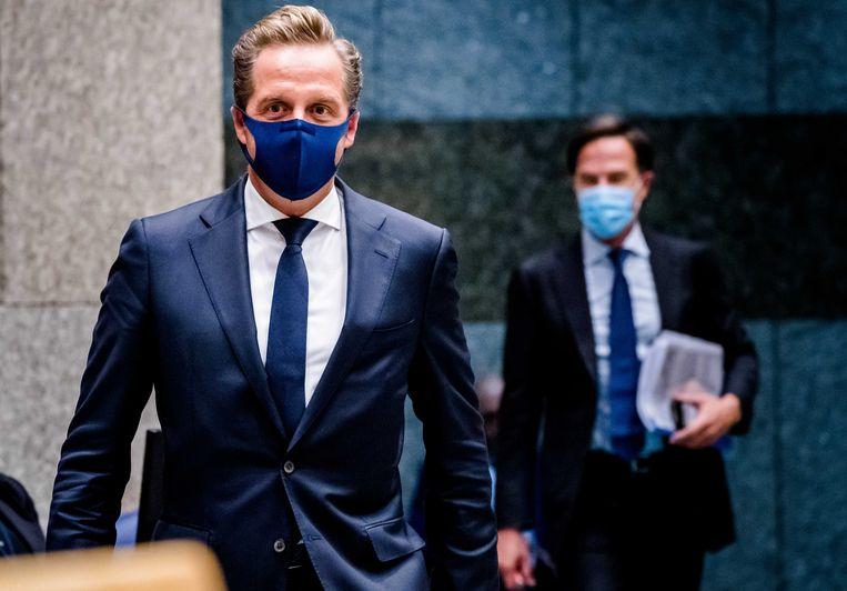 Minister De Jonge en premier Rutte tijdens een debat over het coronavirus.  Beeld ANP