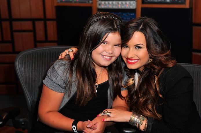 Madison De La Garza et sa demi-sœur, la chanteuse Demi Lovato. Depuis, l'actrice a bien grandi.