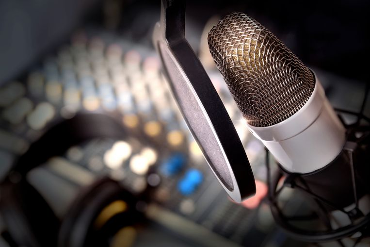 Recording equipment in studio. Studio microphone with headphones and mixer background. Elevated view Beeld Thinkstock
