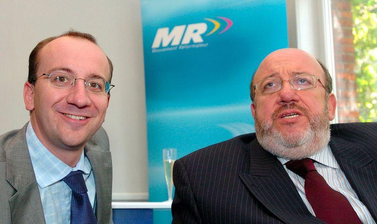 Charles en Louis Michel in 2004, na de benoeming van Didier Reynders tot MR-voorzitter. Beeld BELGA