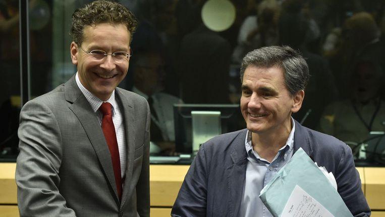Eurogroepvoorzitter Jeroen Dijsselbloem met de nieuwe Griekse minister Euclides Tsakalotos. Beeld AFP