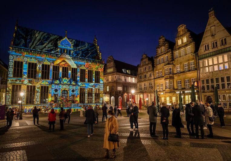 Inwoners in Bremens. De huidige 'lockdown light' in Duitsland wordt verlengd tot minstens 20 december. Beeld EPA