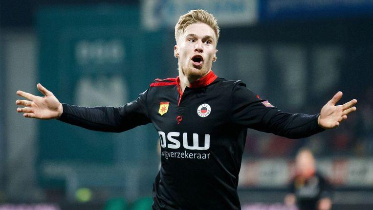 Tom van Weert viert een goal tegen NEC. Beeld photo_news