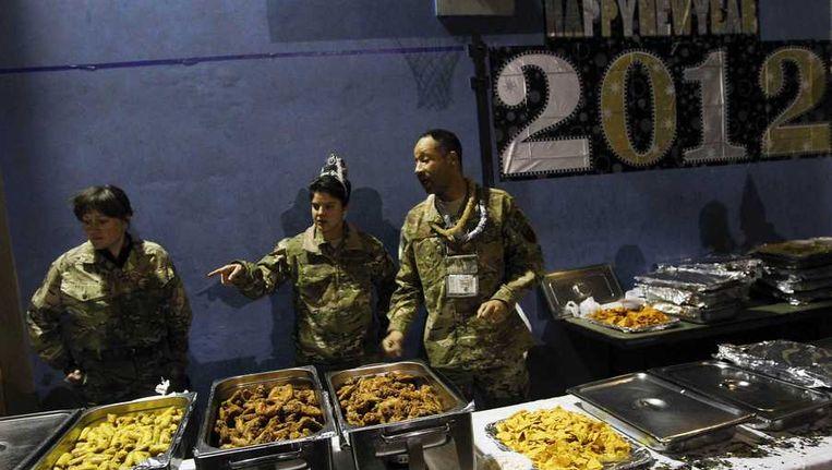 Amerikaanse troepen vieren de jaarwisseling in Kabul. Beeld reuters